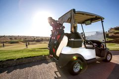 Golf cart on golf course. Golf club. royalty free stock image