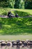 Golf cart on the green Stock Photos