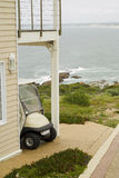 Golf cart at holiday home Stock Photography