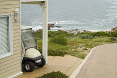 Golf cart at holiday home Royalty Free Stock Images