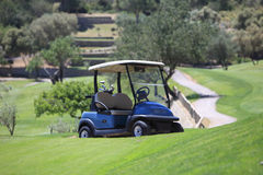 Golf cart parked on a golf course Stock Photo