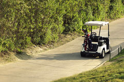 Golf cart parked on road Royalty Free Stock Photos