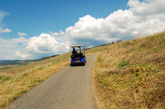 Golf Cart on a Path Stock Images