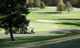 Golf cart by putting green Royalty Free Stock Image