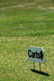 Golf cart sign. Golf cart directional sign in the grass Royalty Free Stock Photo