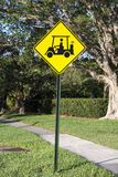 Golf cart sign. Bright yellow golf cart crossing sign Stock Photography