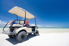 Golf cart at tropical beach. Golf cart at tropical white sand beach in Holbox Mexico Royalty Free Stock Images