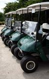 Golf Carts. Four parked empty golf carts Stock Images