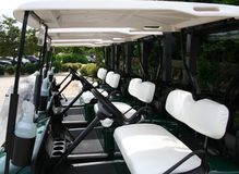 Golf Carts. Four parked empty golf carts Royalty Free Stock Photo