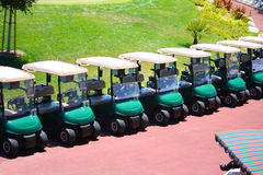 Golf Carts. A row of golf carts at a golf course Royalty Free Stock Photo