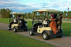 Golf Carts. On the path at the golf course Royalty Free Stock Image