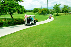 Golf carts. On golf course royalty free stock photography