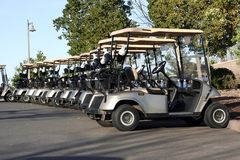 Golf Carts. Row of golf carts at golf course Royalty Free Stock Photography