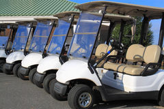 Golf Carts. Row of golf carts closeup Royalty Free Stock Photos