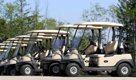 Golf Carts. Parked side by side in a row Royalty Free Stock Photography