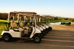 Golf carts. Lined up Stock Photos