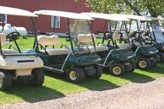 Golf Carts. A row of golf carts stock photo