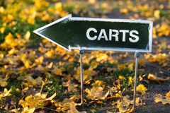 The golf carts direction sign on autumn golf field Stock Photography