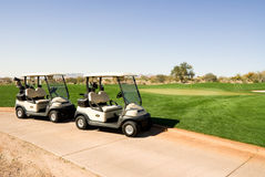 Golf carts on gold course Stock Image