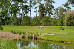 Golf carts on golf course Royalty Free Stock Image