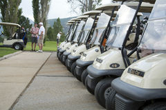 Golf carts in line waiting to be driven Stock Photo