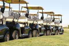 Golf carts lined up Stock Photography