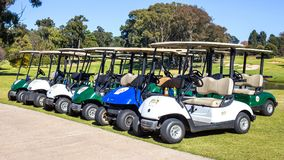 Golf carts parked waiting for players. stock images