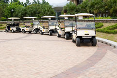 Golf Carts in a Row. A row of empty golf carts waiting for golfers at a country club Royalty Free Stock Images