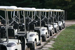 Golf Carts in a Row at a Country Club Royalty Free Stock Images