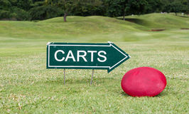 The golf carts sign on a golf field. For the direction Royalty Free Stock Image