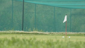 Golf chip and pitch training area. Green area stock video footage