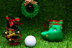 Golf with Christmas ornament on green grass Royalty Free Stock Photo