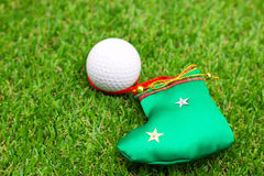 Golf with Christmas ornament on green grass Stock Image