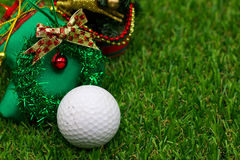 Golf with Christmas ornament on green grass Royalty Free Stock Images
