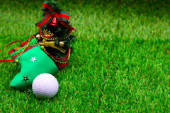 Golf with Christmas ornament on green grass Stock Photo