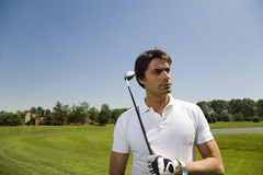 Golf club. Golfer concentrating on the next shot Stock Images