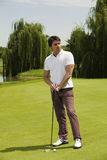 Golf club. Golfer concentrating on the next shot Royalty Free Stock Photography
