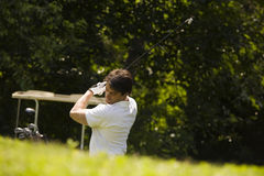 Golf club. Golfer concentrating on the hole-in-one Stock Images