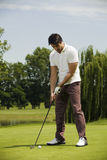 Golf club. Golfer concentrating on the 18th hole Stock Images