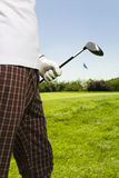 Golf club. Golfer moving to the next hole Royalty Free Stock Photos
