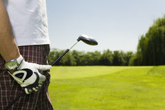 Golf club. Golfer moving to the next hole Royalty Free Stock Image