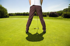 Golf club. Golfer concentrating on the 18th hole stock photos