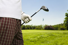 Golf club. Golfer moving to the next hole Royalty Free Stock Photography