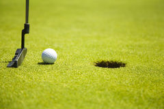 Golf club. Ball close to the 18th hole Royalty Free Stock Photo