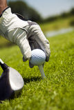 Golf club. Golfer arranging the ball on the tee Stock Photo