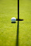 Golf club. Ball close to the 18th hole Royalty Free Stock Images