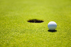 Golf club. Ball close to the 18th hole Stock Photo