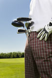 Golf club. Golfer moving to the next hole Stock Images