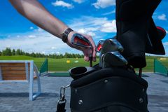 Golf club bag hand. Golf club golfplayer hand take bag lux collect active leisure, set stock image
