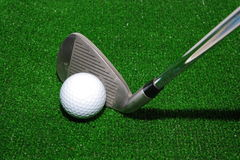 Golf club and ball. On artificial grass Stock Photos